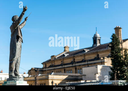 Overlooking the Town Hall, a statue of music composer Gustav Holst in Imperial Gardens, Cheltenham, the town where - Stock Photo