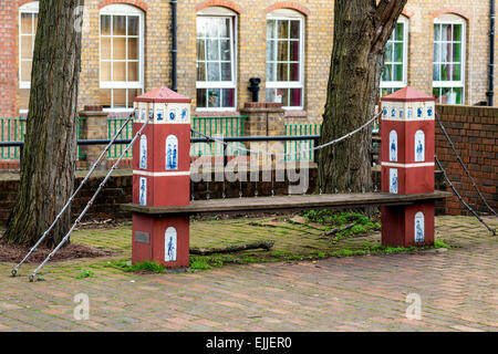 Outside the Brunel Museum in Rotherhithe, London, a park bench has been designed in the design of Brunel's Hungerford - Stock Photo