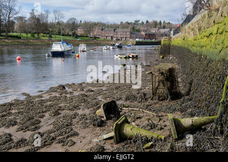 The River Leven, Dumbarton, Scotland, UK at low tide revealing old traffic cones and debris filled shopping trolley. - Stock Photo