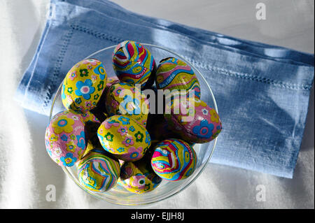 foiled Chocolate Colorful Easter Eggs in glass - Stock Photo