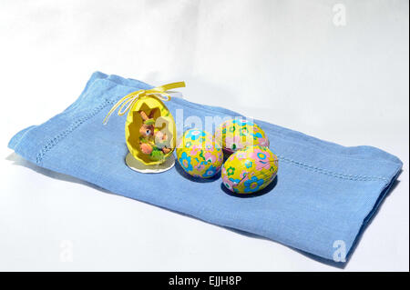 foiled Chocolate Colorful Easter Eggs with Easter Bunny - Stock Photo