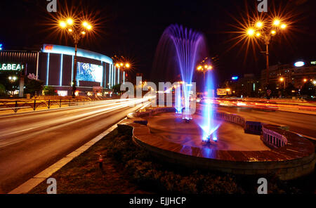 Unirii Square artesian fountain in Bucharest, Romania. - Stock Photo