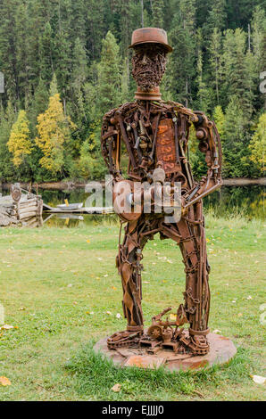 Sculpture made from rusty iron machine pieces, Likely, British Columbia, Canada - Stock Photo