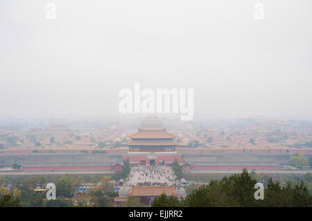 View of the Forbidden City shrouded in pollution from Jingshan Park, Beijing - Stock Photo