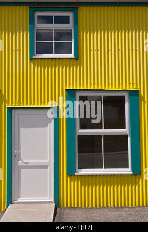 South Atlantic, Falklands, Port Stanley, Philomel St, yellow and green painted house front - Stock Photo