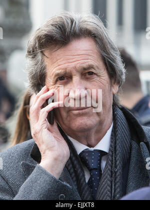 The Lord Bragg or Melvyn Bragg on the telephone outside Westminster Abbey - Stock Photo