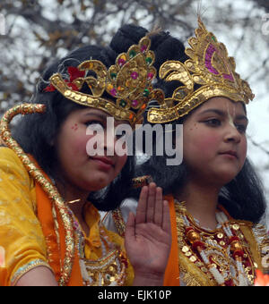 Srinagar, Indian Administered Kashmir:28 March. Kashmiri Hindu children, dressed as Hindu gods, participate in a - Stock Photo