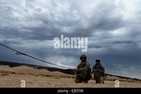 U.S. Army Soldiers from Delta Company, 3rd Squadron, 17th Cavalry Regiment, hold a stabilizing rope attached to - Stock Photo