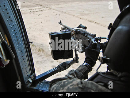CAMP TAJI, Iraq--Spc. Ryan Clark, flight instructor, Company C, 3rd Battalion, 4th Aviation Regiment, Combat Aviation - Stock Photo