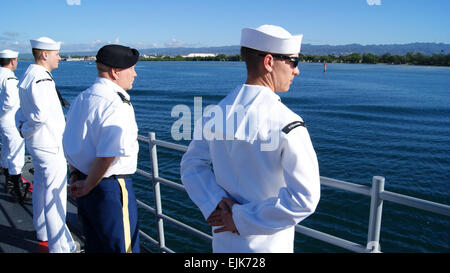 Petty Officer 2nd Class Robert D. Hoyt and Lt. Col. Wes Hoyt stand at ease as the U.S. Navy guided missile cruiser - Stock Photo