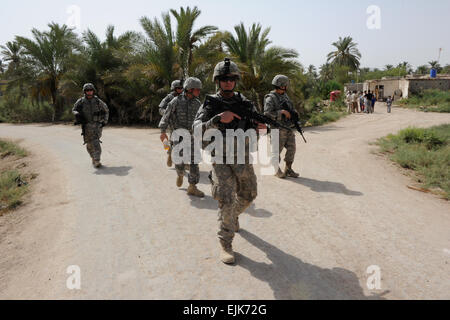 U.S. Soldiers assigned to 3rd Platoon, Bravo Company, 1st Battalion, 68th Armored Regiment, 3rd Brigade Combat Team, - Stock Photo