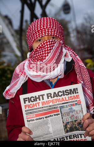 Scarves over the face at Manchester, UK 28th March, 2015. Combined National Front and White Pride Demo in Piccadilly. - Stock Photo