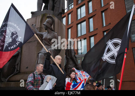 Manchester, UK 28th March, 2015. Far right demonstrators with flags & banners at the National Front and White Pride - Stock Photo