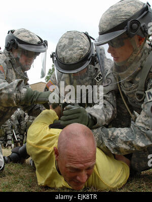 U.S. Army Soldiers from the 130th Military Police Company, Tennessee Army National Guard detain an instructor role - Stock Photo