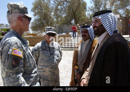 U.S. Army Col. David Leckrone, left, Multi National Division Central South, and Lt. Col. Charles Stasenka, center, - Stock Photo