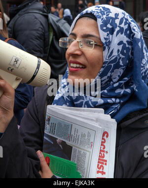 Manchester, UK 28th March, 2015. Asian woman with megaphone loudhailer, opponents to Combined National Front and - Stock Photo