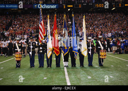 Local service members of the Joint Armed Forces Color Guard presented the colors before the Super Bowl XLVII at - Stock Photo