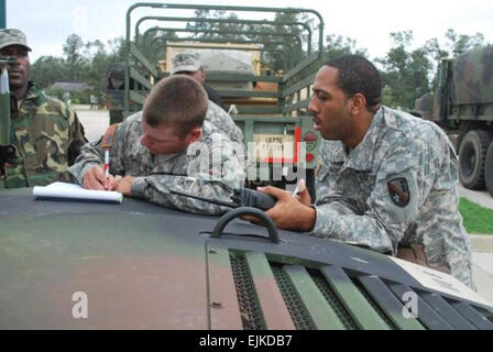 Soldiers of the Louisiana Army National Guard's 225 Engineer Brigade plan the final details of a search and rescue - Stock Photo