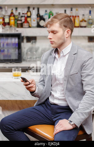 Waiting for friends in the bar - Stock Photo