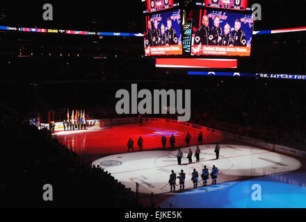 The Joint Armed Forces Color Guard renders honors as the U.S. Army Chorus sings the national anthem before the the - Stock Photo