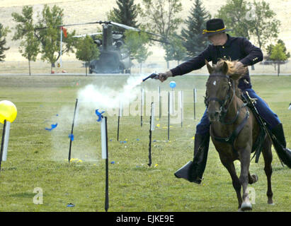 Members of the 89th Montana Cavalry Regiment, Montana Army National Guard perform during a battle streamer dedication - Stock Photo
