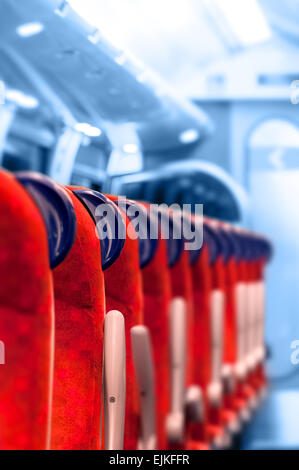Empty Train Seats in a row - Light blue background - Stock Photo