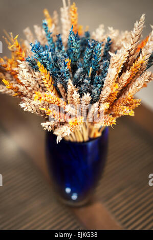 Colorful decorative vase with dried wheat - Stock Photo