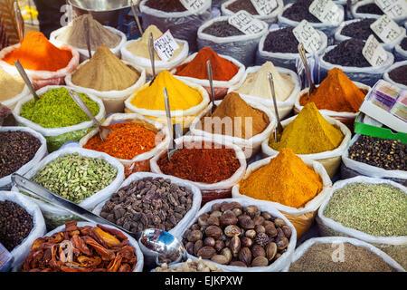 Indian colorful spices at Anjuna flea market in Goa, India - Stock Photo