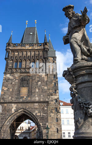 Town Bridge Tower and statue of St. Ivo of Chartres Charles Bridge, Old Town, Prague, Czech Republic - Stock Photo