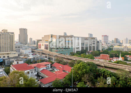 BANGKOK,THAILAND-FEBRUARY 17:Bangkok Mass Transit System (BTS) station at siam paragon and the Pathumwanaram temple - Stock Photo