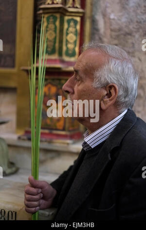 Israel, Jerusalem 29th March. Christian worshipers gather at the Church of the Holy Sepulchre, traditionally believed - Stock Photo