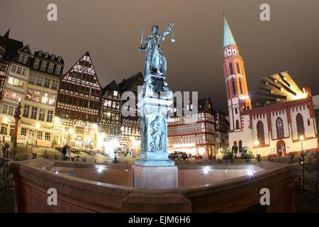 The Fountain of Justice on Roemerberg Square is illuminated in Frankfurt am Main, Germany, 28 March 2015. Starting - Stock Photo