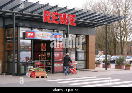 MEPPEN, GERMANY - FEBRUARY 2015: Entrance of a REWE supermarket, part of the REWE Group - Stock Photo