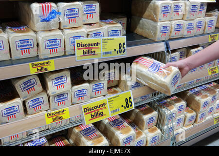 GERMANY - FEBRUARY 2015: Shelves filled with Amercan style packed sliced bread in a Kaufland supermarket - Stock Photo