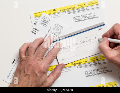 Man Writing Check To Internal Revenue Service Irs Form 1040 Es For