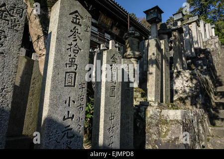 View of gravestones and lanterns at Nigatsu-do Hall in Todaiji Temple, Nara, Japan - Stock Photo