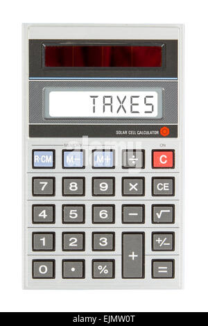 Old calculator showing a text on display - taxes - Stock Photo
