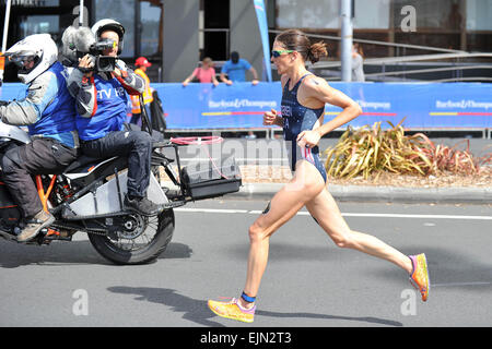 Auckland, New Zealand. 29th Mar, 2015. Gwen Jorgensen (USA) with a TV camera team during the running stage at the - Stock Photo