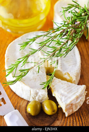 Italian cheese with olives and rosemary - Stock Photo