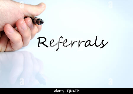 Human hand writing Referrals isolated over white background - business concept - Stock Photo