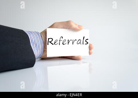 Bussines man hand writing Referrals - Stock Photo