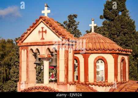 Old colourful Greek Orthodox church dome and bell tower, Fira, Santorini (Thera), Greece - Stock Photo
