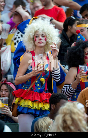 Hong Kong, China. 28th Mar, 2015. Lady wearing puppet doll costume in the famous South Stand at Hong Kong stadium - Stock Photo