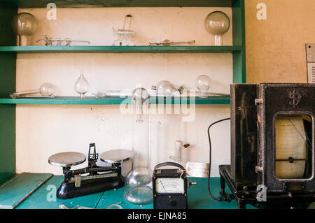 An old laboratory with measuring scales, equipment, glass vessels and valves - Stock Photo