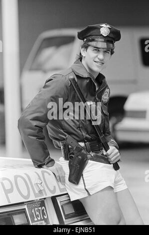1986 World Cup Finals in Mexico. England footballer Gary Lineker dressed in shorts and policeman's jacket and hat, - Stock Photo