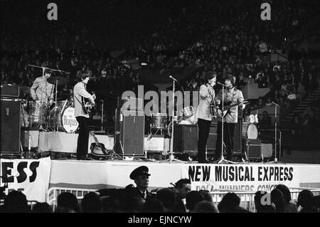 The New Musical Express Poll Winners Concert at Empire Pool, Wembley. The Beatles left to right: Ringo Starr, George - Stock Photo