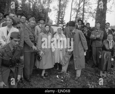 The Queen (centre) seen here with Princess Margaret, King Gustav IV and members of the Swedish Royal family watching - Stock Photo