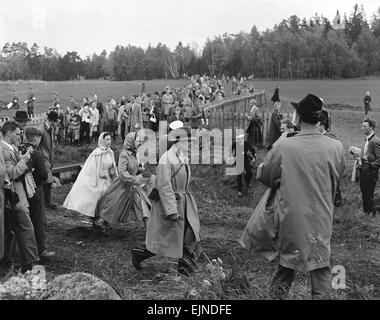 The Queen (centre) seen here with Princess Margaret watching the action in the cross country stage of the 1956 Equestrian - Stock Photo