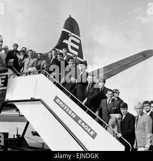 Everton team members wave from their plane before departing Speke airport, Liverpool for Oslo for a pre season warm - Stock Photo