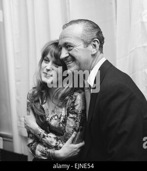 Actor David Niven with French actress Francoise Dorleac pose for photographers shortly before leaving for Lebanon - Stock Photo